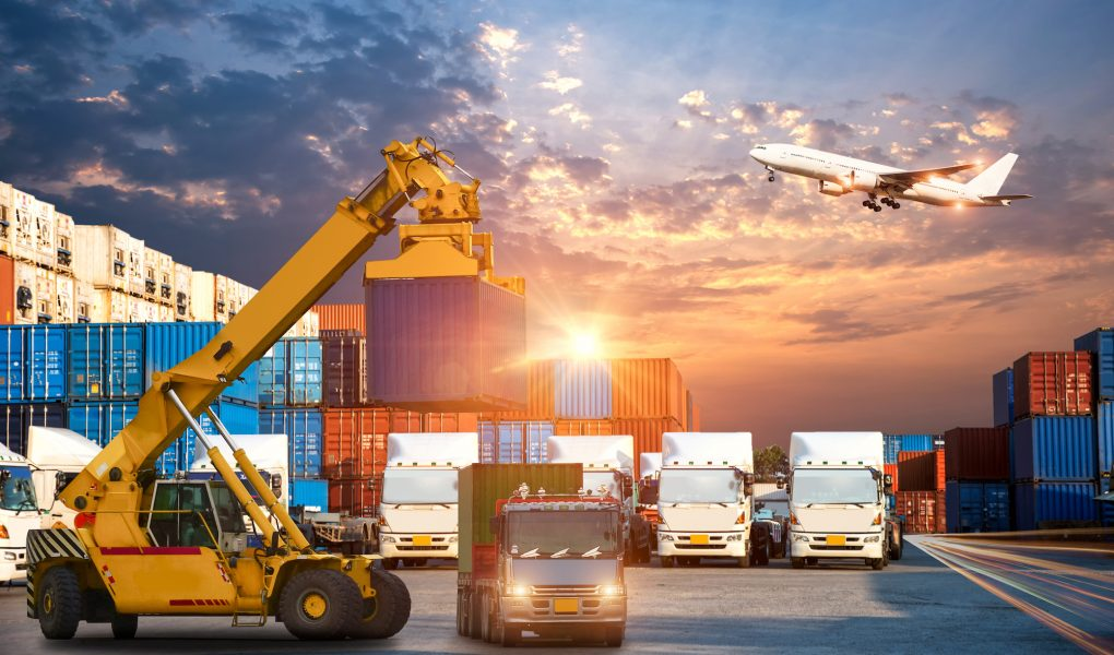 Business Logistics and transportation concept of Container Cargo ship and Cargo plane with working crane bridge in shipyard at sunrise, logistic import export and transport industry background (Business Logistics and transportation concept of Containe